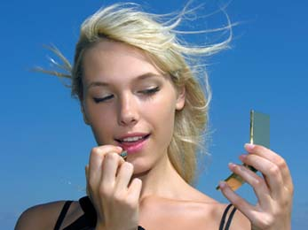 woman applying lip balm with spf