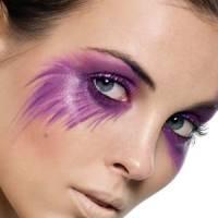 woman wearing purple penciled eye makeup for Halloween