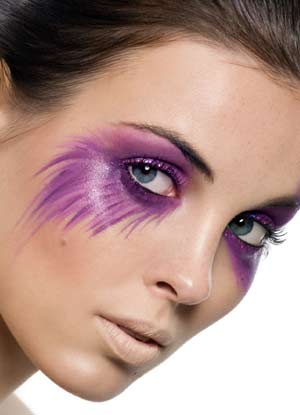 woman wearing purple penciled eye makeup for Halloween