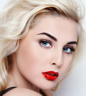 woman wearing pretty red lipstick makeup look